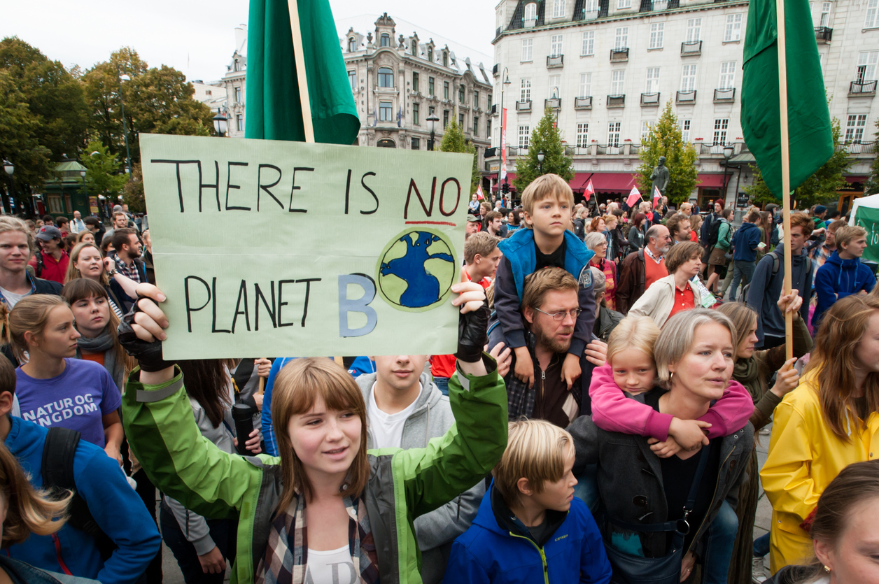 "Oslo, Norway - September 21, 2014: A sign reads, ""There Is No Planet B"", as parents carry children among thousands marching through central Oslo, Norway, to support action on global climate change, September 21, 2014. According to organizers of ""The People's Climate March"", the Oslo demonstration was one of 2,808 solidarity events in 166 countries, which they claim was ""the largest climate march in history""."